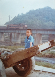 photo-from-grandmother-kim-jae-soon_s-family-album-the-picture-shows-park-chan-hyub-kim-jae-soon_s-youngest-son-against-the-background-of-the-suam-river-circa-1976